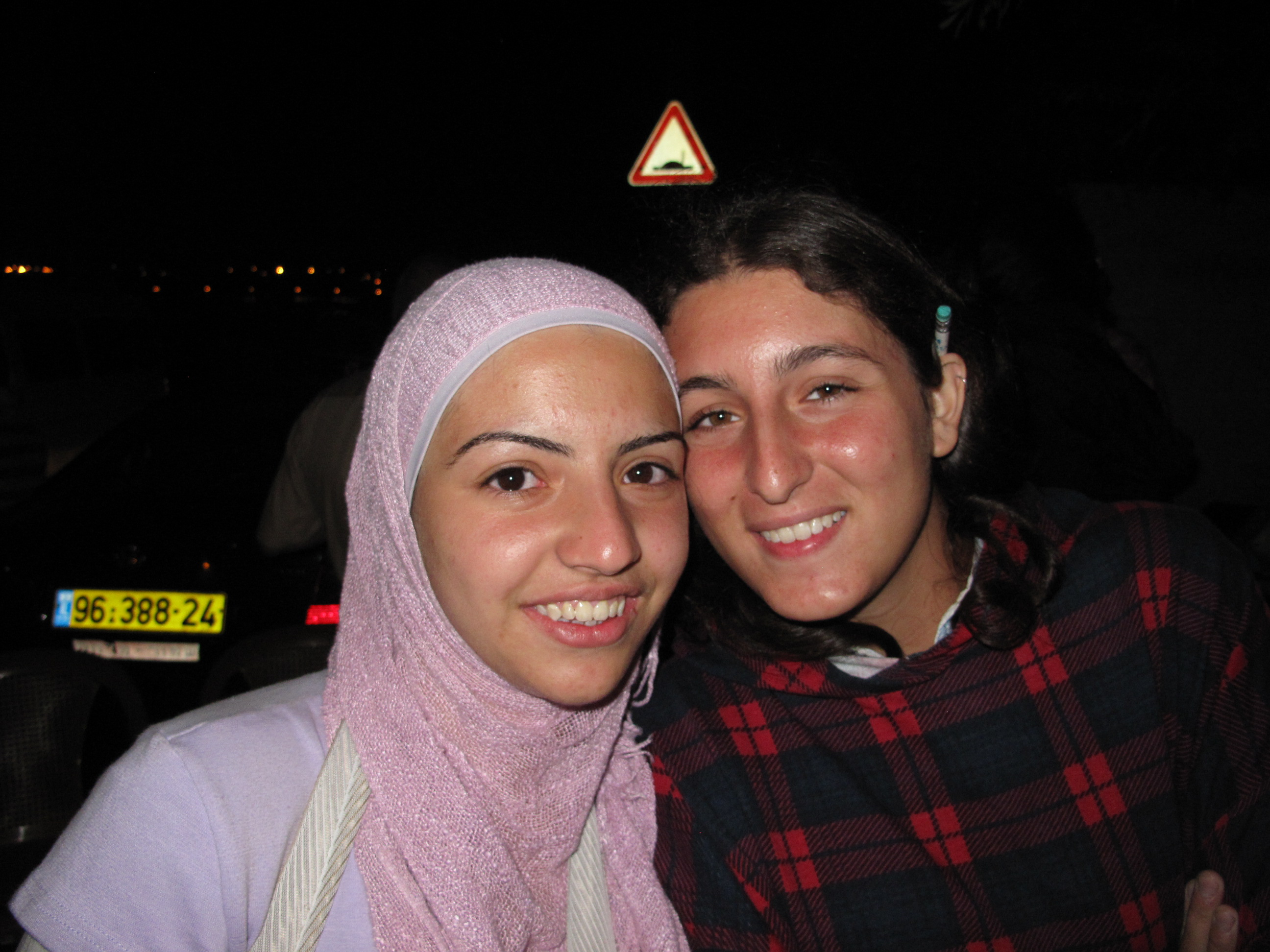 Charihen Hannoun, 20, was hit by police with a rifle, leaving her arm in a sling. She is studying Psychology at Abu Dis University.. She is pictured here with one of the internationals who have been sleeping on the streets in solidarity with the family.