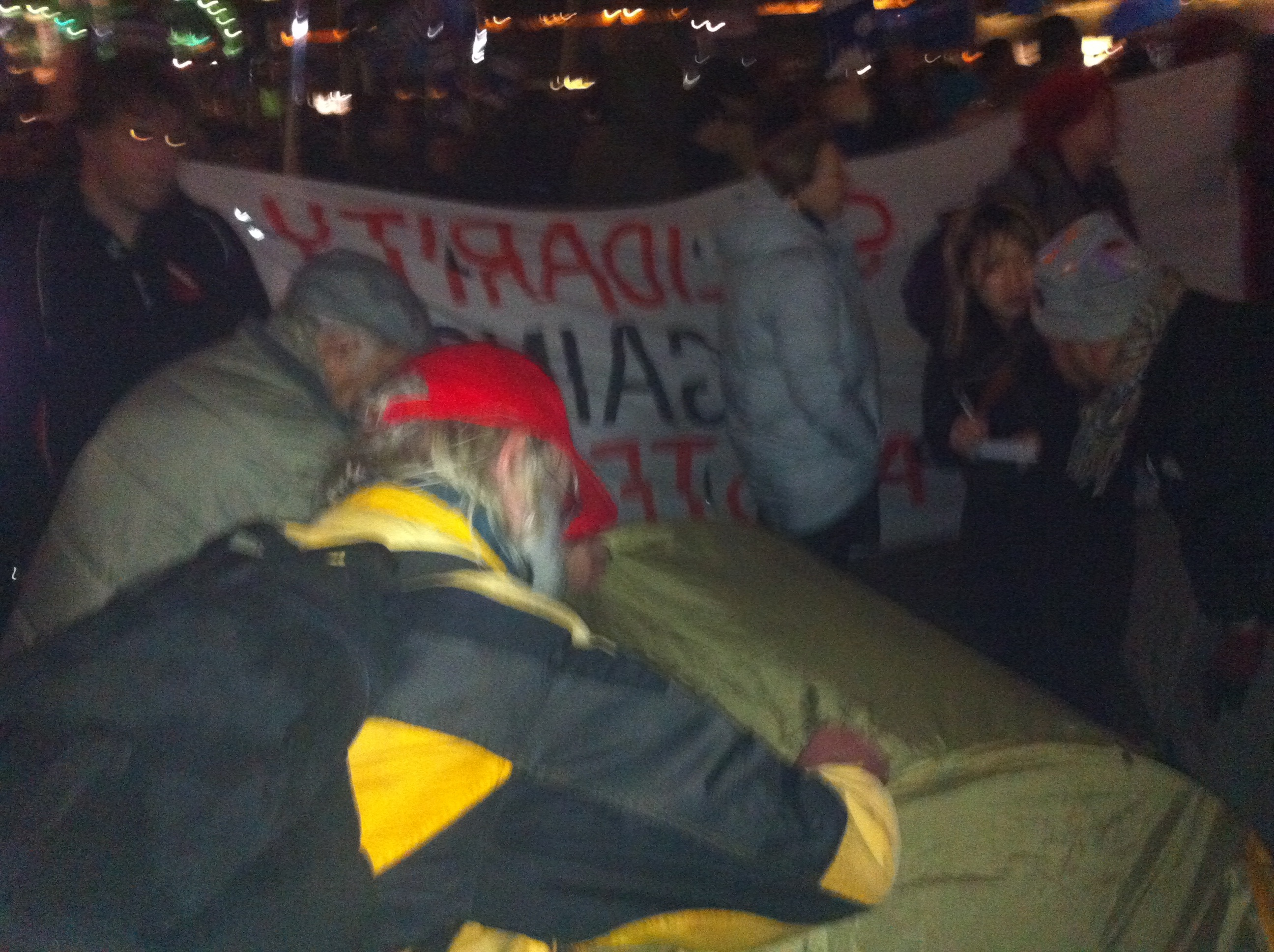 Activists write messages to Ford on Occupy City Hall tents. Photo: Krystalline Kraus