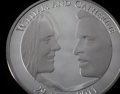 The wedding coin of Prince William and Catherine Middleton, the inspiration for the 'harpie' coin showing Stephen Harper with the Queen.