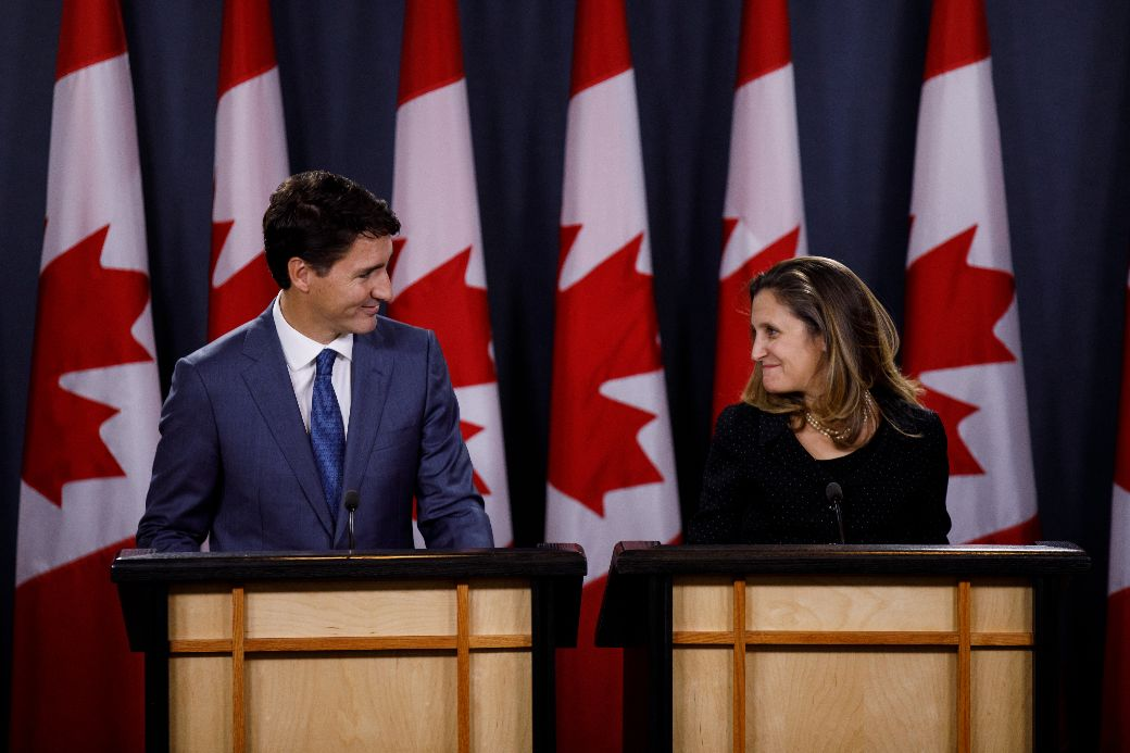 Prime Minister Justin Trudeau and Minister Chrystia Freeland speak with journalists following the conclusion of USMCA negotiations in Ottawa. Photo: Adam Scotti/PMO