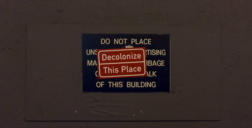 """A sign that reads: """"decolonize this place."""" Image: Billie Grace Ward/Flickr"""