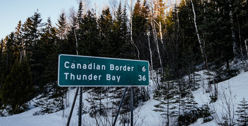 A distance to the Canadian border sign in Minnesota. Image: Tony Webster/Flickr