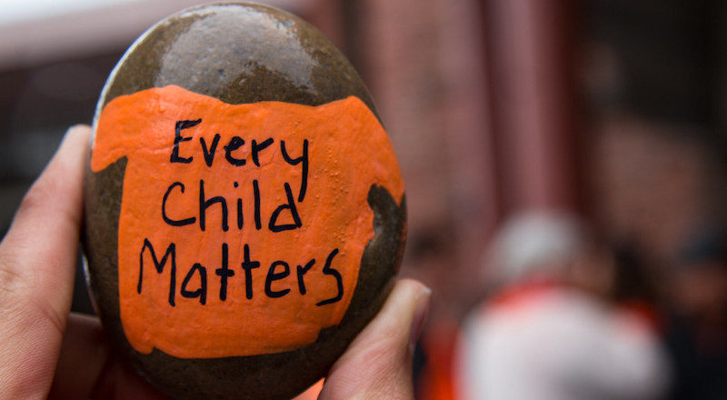 Every Child Matters painted on a pebble. Image: BC Gov/Flickr